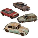 This is a set of very damaged and abandoned cars, ...