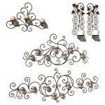 4 different wrought iron wall hung candle holders.