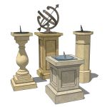 A collection of sundials on stone plinths.