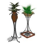 Wrought iron vase stand plants by others are not i...